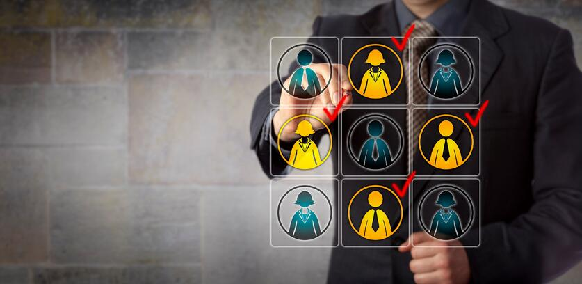 Business man using workforce management technology to view employee activity.