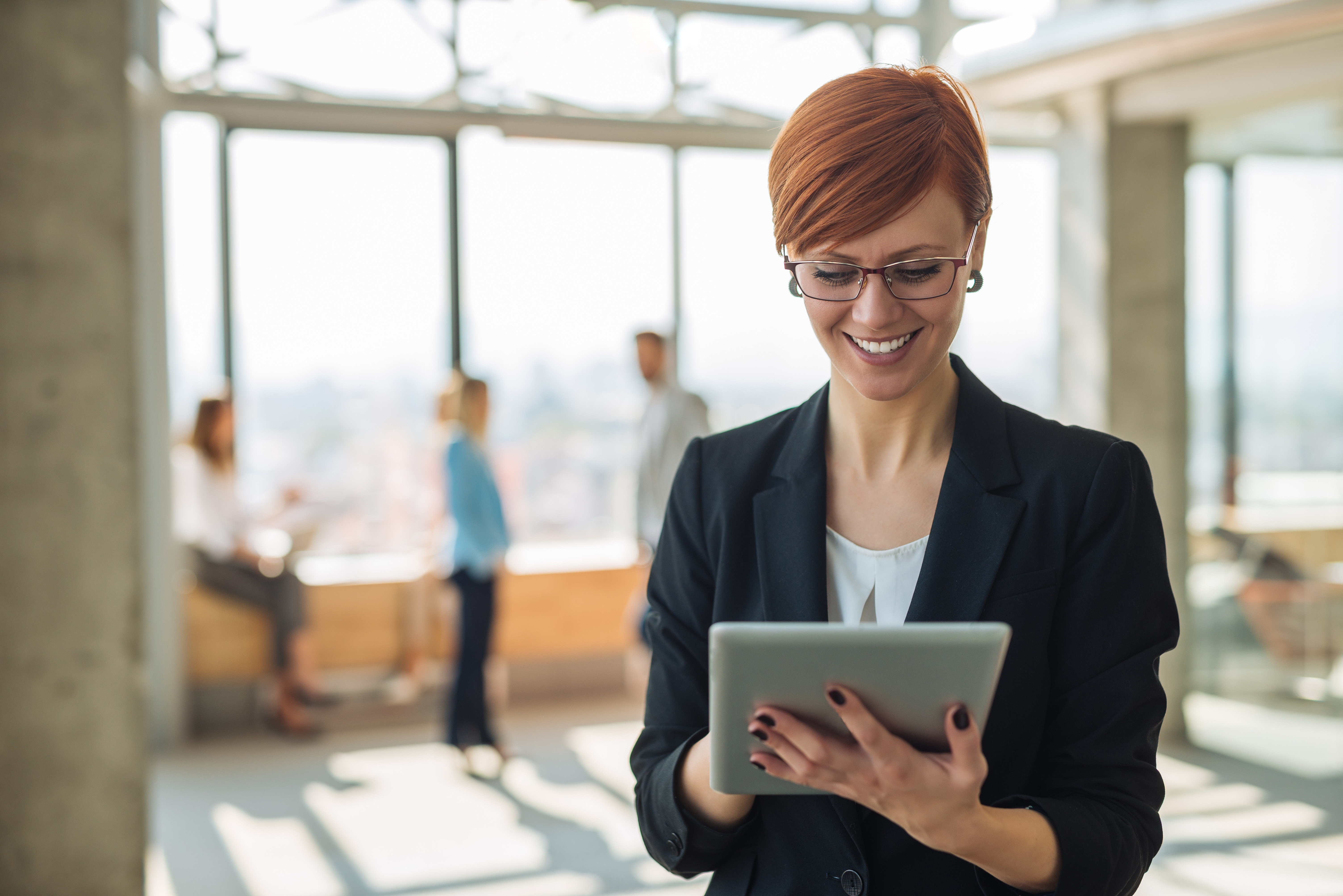 HR Manager holding a tablet.